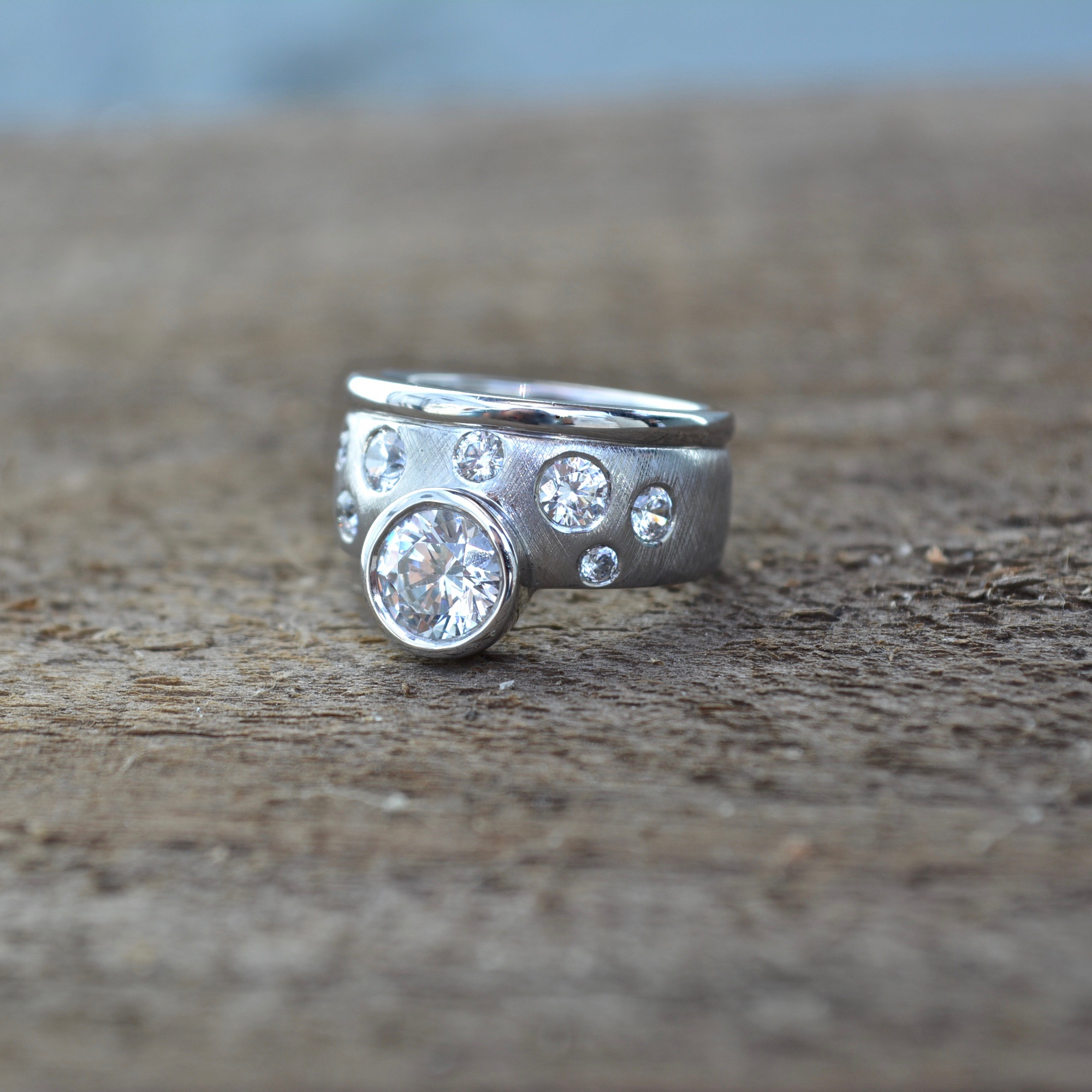 Pure Envy wide engagement ring with bezel feature