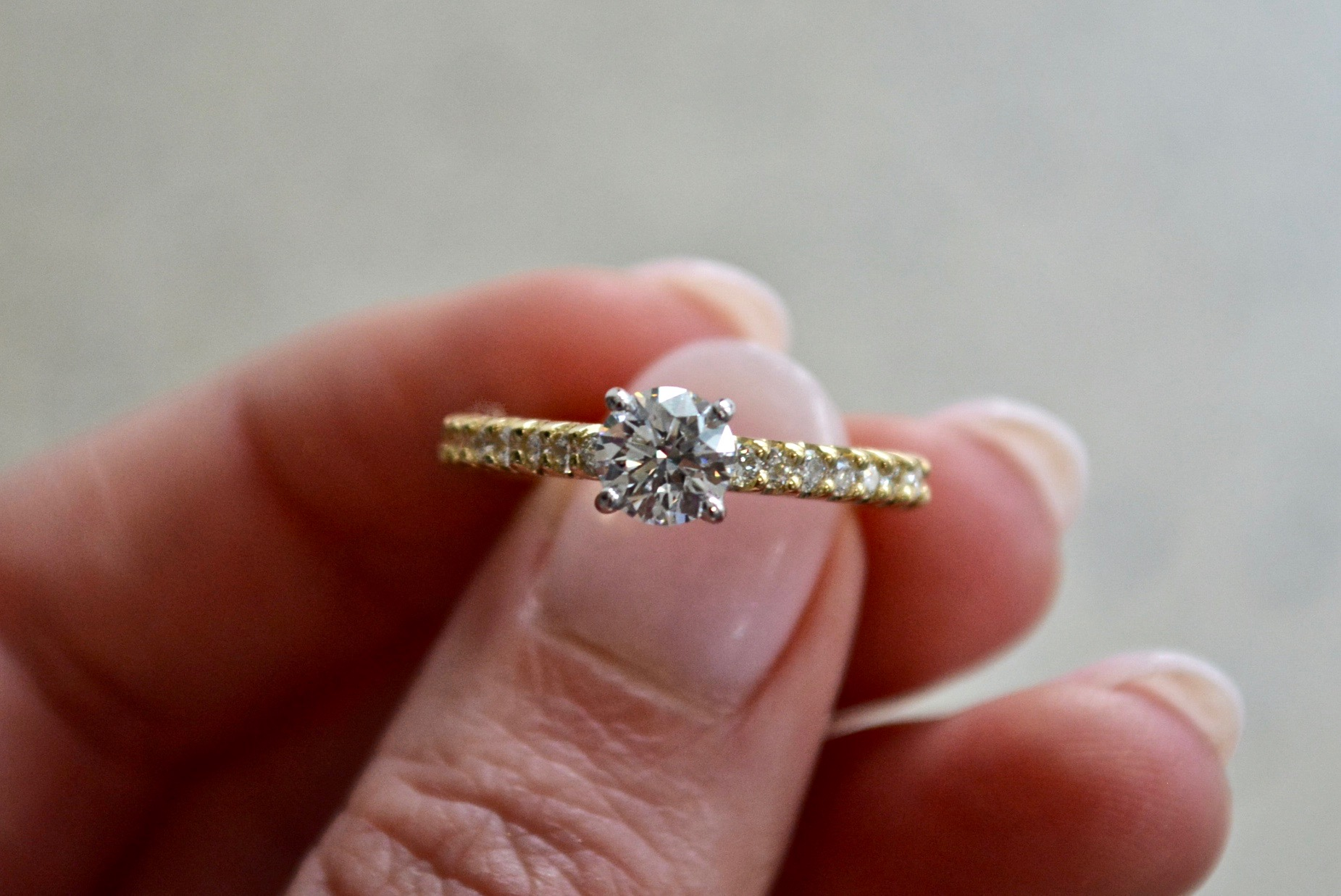 Yellow Gold shared claw Engagement Ring