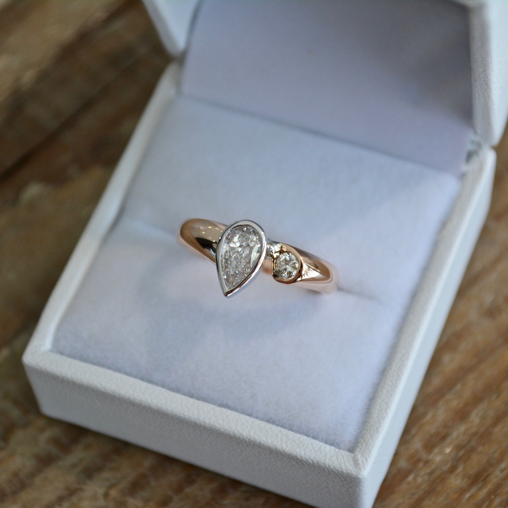 Pure envy wide pear shape off-set ring