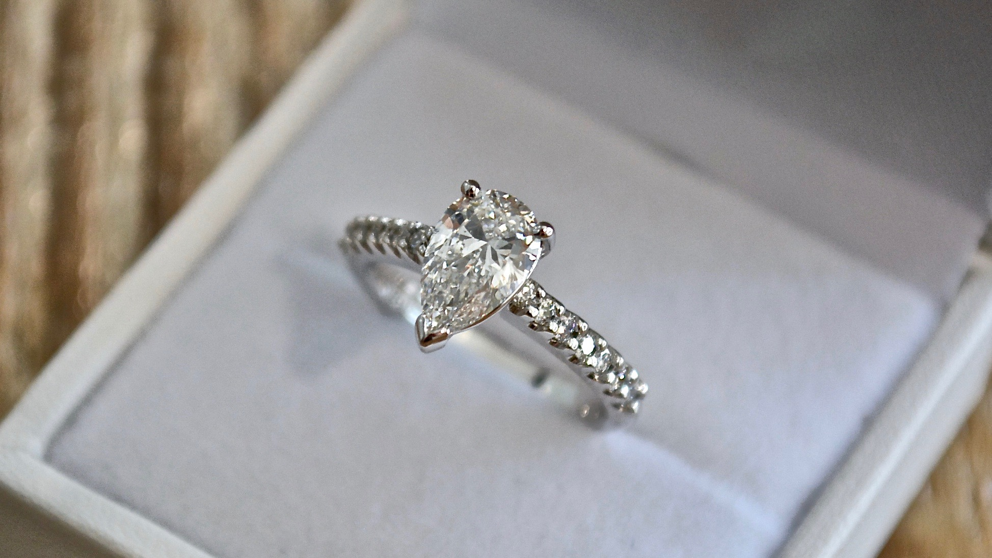 Pear diamond with diamonds in band