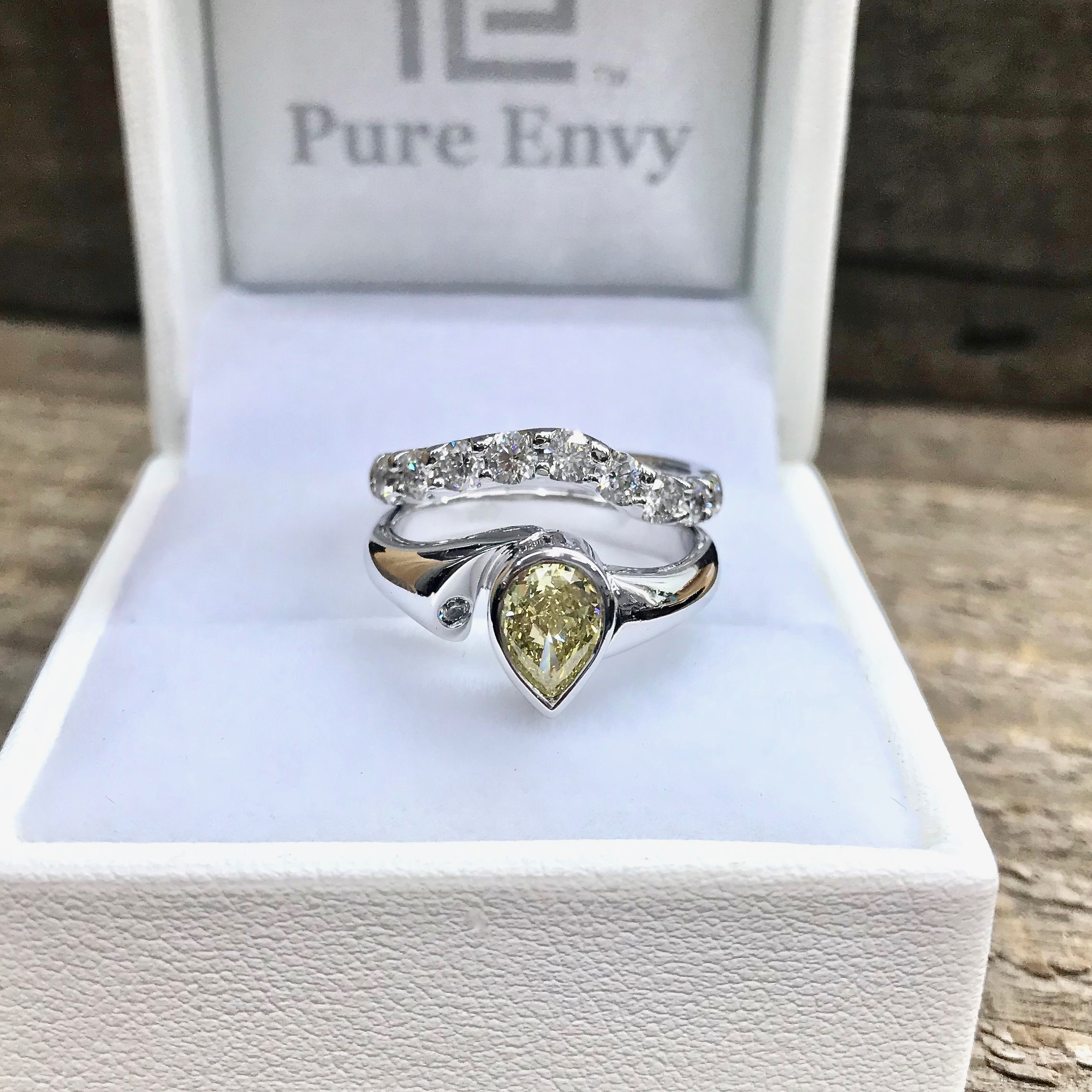 Yellow diamond pearshapes engagement ring