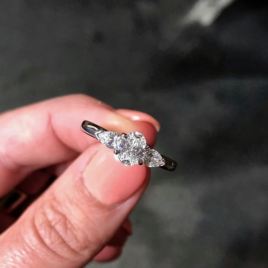 Oval trilogy engagement ring
